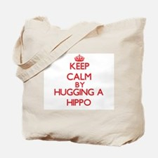 Keep calm by hugging a Hippo Tote Bag