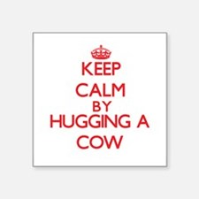 Keep calm by hugging a Cow Sticker