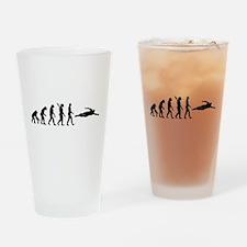 Swimming evolution Drinking Glass