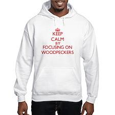 Keep calm by focusing on Woodpeckers Hoodie