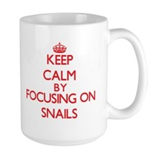 Keep calm by focusing on Snails Mugs
