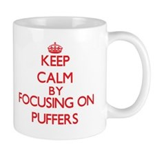 Keep calm by focusing on Puffers Mugs
