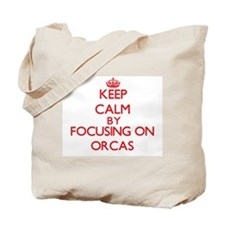 Keep calm by focusing on Orcas Tote Bag