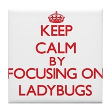 Keep calm by focusing on Ladybugs Tile Coaster
