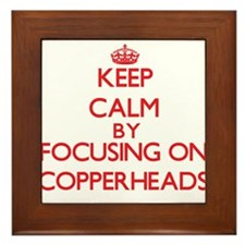 Keep calm by focusing on Copperheads Framed Tile