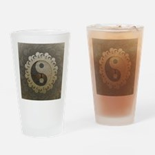 Yin Yang in tan colors with tree of life. Drinking