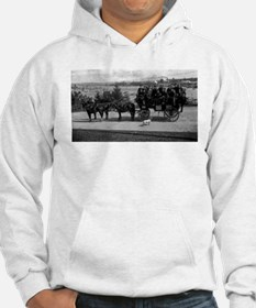 Men riding in a Tally-ho Hoodie