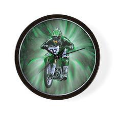 Dirt biker blasting thru green Wall Clock