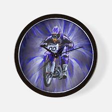 Dirt biker blasting thru blue Wall Clock