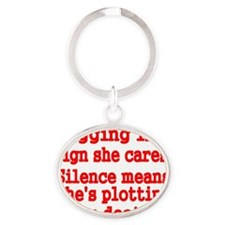 Nagging is a sign she cares Oval Keychain