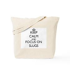 Keep calm and focus on Slugs Tote Bag