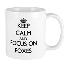 Keep calm and focus on Foxes Mugs