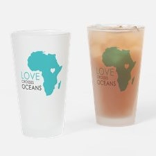 Love Crosses Oceans Drinking Glass