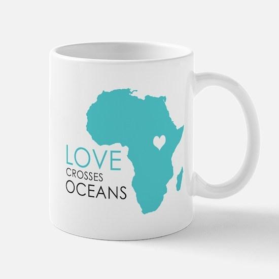 Love Crosses Oceans Mugs