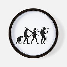 Female Hiker Evolution Wall Clock