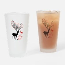 Oh my deer, stag and doe with red hearts Drinking