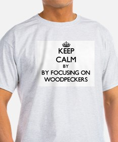 Keep calm by focusing on Woodpeckers T-Shirt
