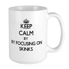 Keep calm by focusing on Skinks Mugs