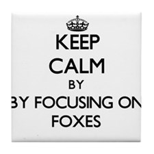 Keep calm by focusing on Foxes Tile Coaster