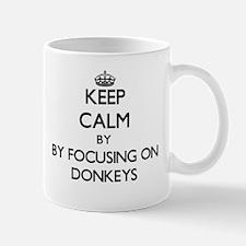 Keep calm by focusing on Donkeys Mugs
