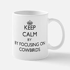 Keep calm by focusing on Cowbirds Mugs