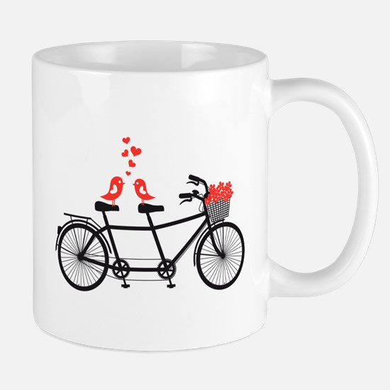 tandem bicycle with cute love birds Mugs