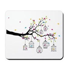 tree branch with birds and birdcages Mousepad