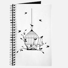 Free birds with open birdcage Journal