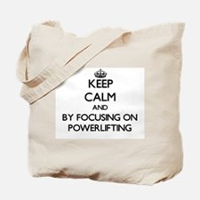 Keep calm by focusing on Powerlifting Tote Bag