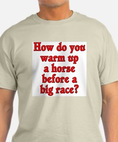 How do you warm up a horse before a race?
