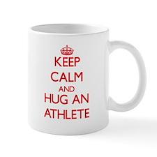 Keep Calm and Hug an Athlete Mugs