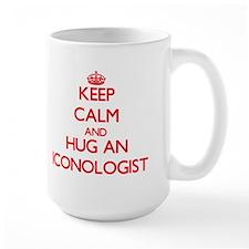 Keep Calm and Hug an Iconologist Mugs