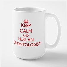 Keep Calm and Hug an Odontologist Mugs
