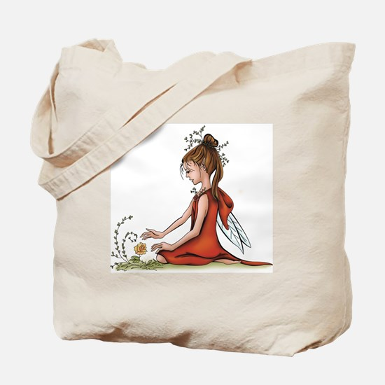 woodland fairy admires a rose Tote Bag