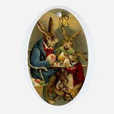 ester rabbits painting eggs Oval Ornament