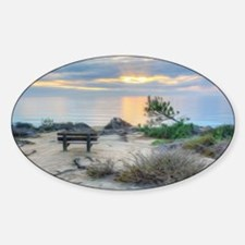 An empty bench at sunrise Sticker (Oval)