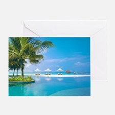 Beach chairs with umbrellas with sun Greeting Card