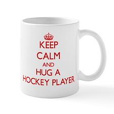 Keep Calm and Hug a Hockey Player Mugs