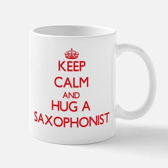 Keep Calm and Hug a Saxophonist Mugs