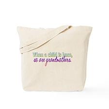 When A Child Is Born Tote Bag