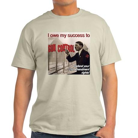 """I Owe It All To Gun Control"" Light T-Shirt"