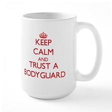 Keep Calm and Trust a Bodyguard Mugs