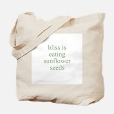 bliss is eating sunflower see Tote Bag