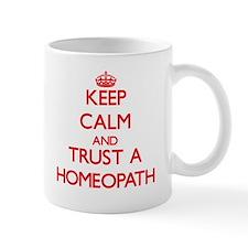 Keep Calm and Trust a Homeopath Mugs