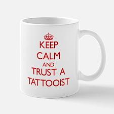 Keep Calm and Trust a Tattooist Mugs