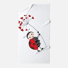 ladybug with heart tree Beach Towel