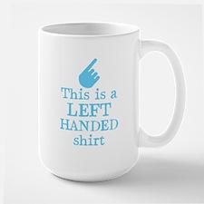 Left handed shirt in blue Mugs