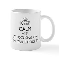 Keep calm by focusing on Ithf Table Hockey Mugs