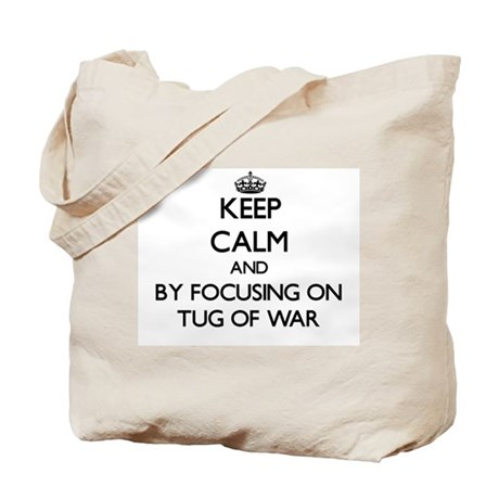 Keep calm by focusing on Tug Of War Tote Bag
