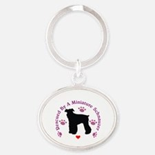 Rescued By A Miniature Schnauzer 111 Oval Keychain